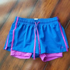Active wear, champion shorts, xs Cute pink and blue champion shorts. Size xs Shorts