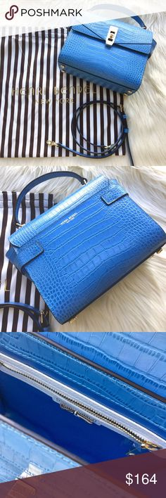 Brand new Henri bendel uptown mini croco satchel Purchase comes with original Henri bendel pouch as pictured. Light blue and croco embossed leather. Flap push lock closure. Removable and adjustable shoulder strap 20.5'' - 22.5''L. Dimensions 7''H X 10'' W X 3.5'' D. No trade pls. henri bendel Bags Crossbody Bags