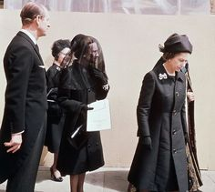 6/5/1972-Windsor, England- The Duchess of Windsor, the American-born twice-divorced woman for whom a King of England gave up his throne, walks from his funeral service with Queen Elizabeth II and Prince Philip. Cut off from the royal family in 1936 which made Edward VIII the exiled Duke of Windsor, the Duchess was making her first ,and probably last, public appearance with the royal family in England since that time. She left by air for Paris immediately after the burial.