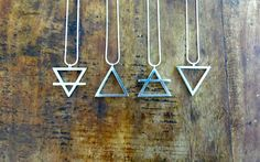 Four elements jewellery - a set of four pendants bearing the alchemical symbols for the four elements.
