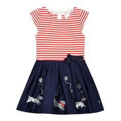 This attractive, sparkly dress is ideal for a party! It has a smart bow on the front and the skirt features a row of sequinned dogs & balloons, has a layer of tulle netting under it to make it puff out.  The top of the dress is a red & white cotton jersey fabric with a back neck button fastening and the skirt is a navy, crisp cotton fabric. #puppy