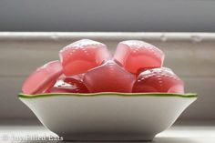 a side view of a white dish of low carb gummies
