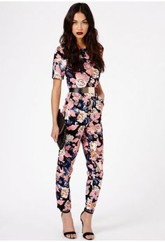 Straight out of our HOT new party edit, this statement #jumpsuit is one of our ultra favorite pieces. With its cool #colour pop #florals, it's ideal for brightening up those dreaded winter blues. Keep it simple with a chic stiletto heel and clutch.