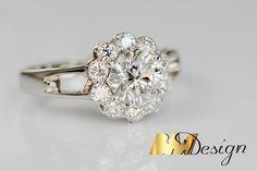 Pierścionek z dużym diamentem, z białego złota. Piękny diament w otoczeniu mniejszych diamentów o szlifie brylantowym w oprawie BM Design Rzeszów. #diamondring #diamondjewelry #custommade #customjewelry #diament #pierścionek #engagementring