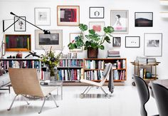 Amazing gallery wall with graphic art. We love the different colored frames.