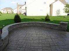 Patio with Unilock Brussels Dimensional seating wall.