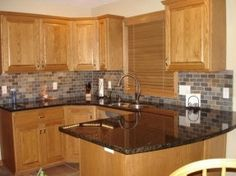Kitchen Backsplash For Black Granite Countertops honey oak kitchen cabinets with black countertops |  pearl or