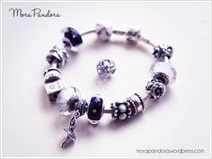 Today's post sees the start of my reviews of the Pandora Winter 2014 collection, with an in-depth look at the stunning new Midnight Effervescence murano (or Midnight Blue Fizzle, if you're in the U...