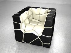 Inspired by the Voronoi diagram, each pillow has a neodymium magnet. 13 pillows and cubes turned into a chair to sit. Each pillow beneath the surface of a magnet which hold the entire structure together. Chair Vuzzle by Christopher Daniel pillow made of 59 cells. Available in three different color patterns, Vuzzle Milk, Vuzzle Vuzzle Neat and Bloody Marys