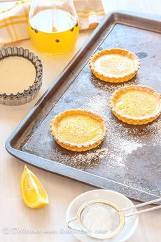 Gin & Tonic Tarts - why choose between a cocktail and dessert when you can have both with these cute little gin and tonic lemon tarts   deliciouseveryday.com