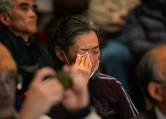 Hundreds protest dropped charges over Fukushima crisis. Here a woman wipes away a despairing tear at the rally in Tokyo on March 1, 2014