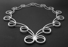 """Necklace   Cheryl Eve Acosta.  """"Double Spiral"""".  Sterling silver"""