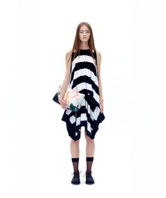 This MARIOS SS14 Line Dress has two layers. The lower part of the dress has an elastic waistband, which can be used to adjust the position of the waistline or to drape the flowy jersey around the body in different ways. Material 100% cotton. Made in Poland. Colors black and white. Dress can be washed by hand in 30 degrees.