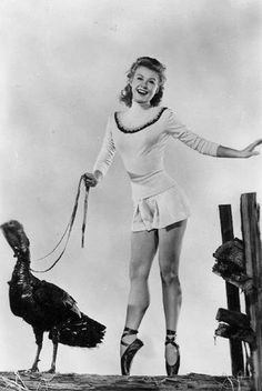 Pointe shoes -  the only sensible choice for when you're walking your turkey.  Vera Ellen