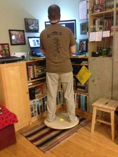 DIY balance board - uses a softball for the pivot. This is what people need with the new stand-up desks.
