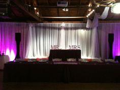 Sweet Heart Table on stage, Head Table below, Uplighting Fixtures