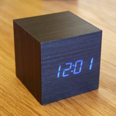 """Can't wait to decorate my own place with this!  """"This desktop piece is an innovative, eco-friendly wooden alarm clock that lights up with the time, date, and temperature whenever you wish. If you need to check the time, just click your fingers or gently tap your bedside table and the time will appear; you'll never have to grapple for your smartphone again.""""  On sale at TouchOfModern"""
