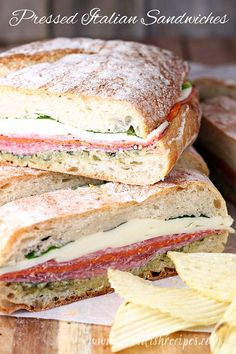 Pressed Italian Sandwiches: Italian meats and cheeses are layered with pesto and fresh basil, then wrapped and pressed in these flavorful sandwiches that are perfect for picnics and parties. #sandwiches #recipes #picnicfood