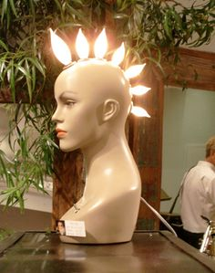 What an amazing upcycle! Mannequin with light bulbs, such a crazy, cool look.