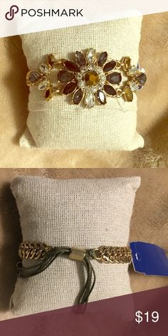 Floral Rhinestone Bracelet Multi-color rhinestone bracelet with pull string closure.  NWT Jewelry Bracelets