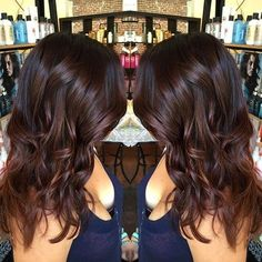 medium wavy chocolate brown hairstyle