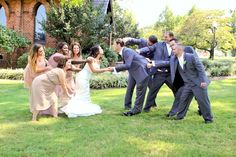 Bridal Party Pulling Bride and Groom Away