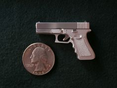 Handmade miniature Glock 17, in 1/5 scale, 2mm single shot pinfire. See how this miniature gun was made on my youtube channel: https://www.youtube.com/watch?v=lngdOtG539Y