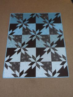 2010. Orion's star lap quilt made for my-brother-in-law and his family.  Done in browns and teals.