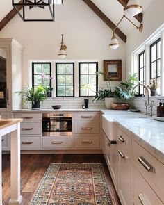 modern farmhouse kitchen brown ceiling wood beams black modern chandelier white cabinets white marble black windows gold light fixtures built in microwave colorful kitchen rug Home Decor Kitchen, Kitchen Interior, New Kitchen, Home Interior Design, Home Kitchens, Kitchen White, Kitchen Wood, Kitchen Modern, Kitchen Rug
