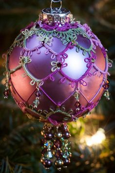 Lace Beaded Christmas Ornament: Needle Tatting Purple Amethyst and Green Peridot with Crystal Christmas Ball.  No pattern, just inspiration.