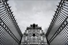 Los Angeles, USA - cemetery gates on a foreboding morning (by Ivan Lo)
