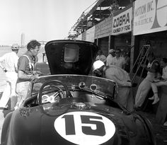 1963 12 Hours of Sebring   Phil Hill looking over the Shelby Cobra that he and Dan Gurney would drive in practice