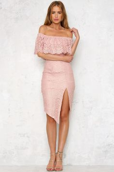 The gorgeous Turning Heads Midi Dress features an off-the-shoulder neckline with layered bust. It's made of stunning lace material with a slight metallic sheen to it. There's a small slit on the front side for easy movement and a visible zipper on the back. Style yours with black patent stilettos and a bright red lip to steal the show! Midi dress. Lined. Cold hand wash only. Model is standard XS and is wearing XS. True to size. Non stretchy fabric, elasticated top. Polyester.