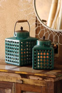 set of two ceramic lanterns with metal tops and wooden handles