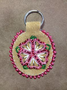 Dark Pink Flower with porcupine quills on traditional smoked moose leather key chain by Alaska Beadwork