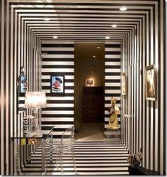 hallway-walls-ceilings-floors-in-black-and-white-stripes via jordanguidedesign