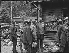 Miners bring in their checks and see the sign that there is no Saturday work. Lejunior, Harlan County, KY. 13 September 1946. Russell Lee Photographic Collection, 1979, 79PA103. Special Collections, University of Kentucky Libraries.