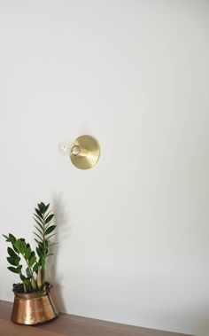 "Flush Mount sconce-Raw Brass ø 5"" W x 3"" H (without bulb) ø Ceramic socket 75 watt / 250 volt ø All solid materials ø hard wire to ceiling or wall  ø All mounting hardware is included ø Any standard sized E-26 screw in bulbs are accepted.  Bulb not included.  If you need help finding some,"