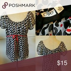 Black, white & red blouse Light sheer top with red ribbon / bow in the front. Great with jeans or capris. Cato Tops Blouses