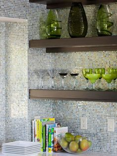 We love the glass mosaic tile in this modern kitchen! More backsplash inspiration:  http://www.bhg.com/kitchen/backsplash/glass-tile-backsplash/?socsrc=bhgpin101913mosaictile