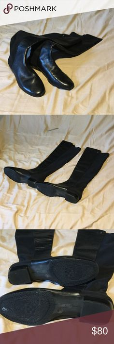 Vince Camuto boots Karita black leather over the knee riding boots. The front is soft leather with soft suede inside. The back is neoprene. They do stretch, but are tight right above my knee. My measurement there is 19 inches around. I have not worn them outside, but the leather front shows signs of being moved around in my closet. I Vince Camuto Shoes Over the Knee Boots