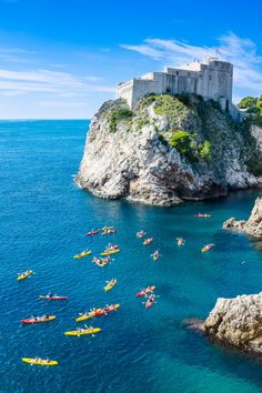 Kayakers near Dubrovnik, Croatia as seen from the old city wall. The castle in the background is flying the Lannister flag.