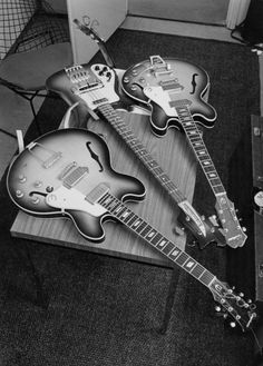 Epiphone guitars belonging to George Harrison and John Lennon, along with Paul McCartney's Rickenbacker bass (center), backstage before a concert at the Ernst Merck Halle, Hamburg, during the Beatles' last world tour - June 26, 1966. Photo by Robert Whitaker