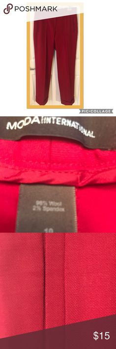 MODA Red pant size 10. MODA International red pant size 10.  Made by Victoria Secrets. Pants have cuffs, double welt front pockets, zippered front closure with trouser front closure.  Trouser pocket on back.  98% Wool 2% Spandex. Dry clean only. Moda International Pants Trousers