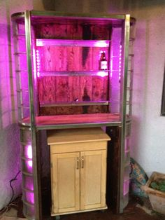 Pallet wood and stainless steel cannery scrap repurposed into Art Deco bar. Total cost = $50 for color changing LED lights