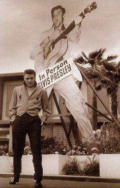 Elvis Presley standing in front of himself