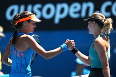 Ana Ivanovic and Eugenie Bouchard Photos Photos - Eugenie Bouchard of Canada shakes hands with Ana Ivanovic of Serbia after Bouchard won their quarterfinal match during day nine of the 2014 Australian Open at Melbourne Park on January 21, 2014 in Melbourne, Australia. - Australian Open: Day 9