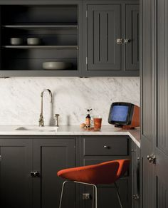 love the dark cabinet/light marble juxtapostion, as well as the shaker cabinet vibe paired with the super modern and colorful accessories.