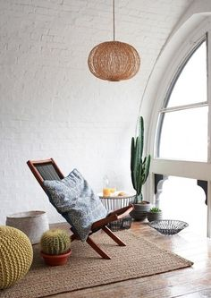 Reading nook, desert style. Don't be afraid to start your focal point in the center of the space! Complete harmony found in colors, placement & styling.