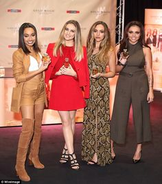 Sweet smell of success: The singers - along with Jade Thirlwall and Jesy Nelson - looked i...